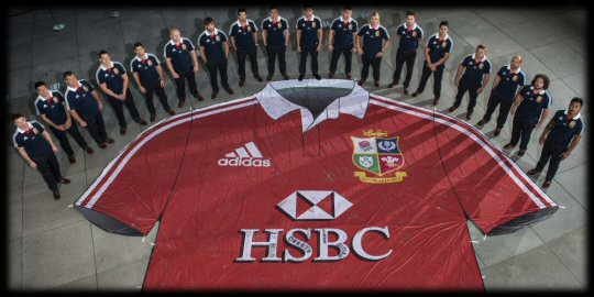 Members of the 2013 squad with the giant Lions shirt in HK